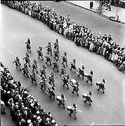 17/03/1959<br /> 03/17/1959<br /> 17 March 1959<br /> St. Patricks Day Parade in Dublin. Image shows the Emerald Girl pipe band parading.