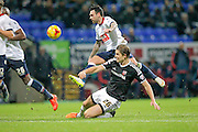 Mark Davies (Bolton) shot is blocked by James Tarkowski (Brentford) during the Sky Bet Championship match between Bolton Wanderers and Brentford at the Macron Stadium, Bolton, England on 30 November 2015. Photo by Mark P Doherty.
