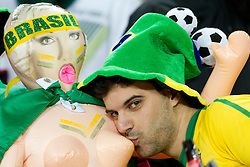 A Brazil fan kisses doll's breast prior to  the 2010 FIFA World Cup South Africa Group G Second Round match between Brazil and République de Côte d'Ivoire on June 20, 2010 at Soccer City Stadium in Soweto, suburban Johannesburg, South Africa. (Photo by Vid Ponikvar / Sportida)