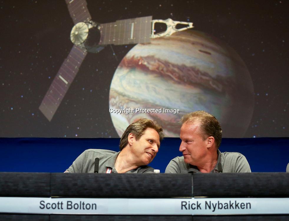 Scott Bolton, left, and Rick Nybakken, in a post-orbit insertion briefing at NASA's Jet Propulsion Laboratory following the solar-powered Juno spacecraft entered orbit around Jupiter on Monday July 4, 2016 in Pasadena,  Calif. (AP Photo/Ringo H.W. Chiu)