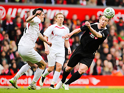 Charlie Adam flicks the ball past Martin Kelly - Photo mandatory by-line: Dougie Allward/JMP - Mobile: 07966 386802 - 29/03/2015 - SPORT - Football - Liverpool - Anfield Stadium - Gerrard's Squad v Carragher's Squad - Liverpool FC All stars Game