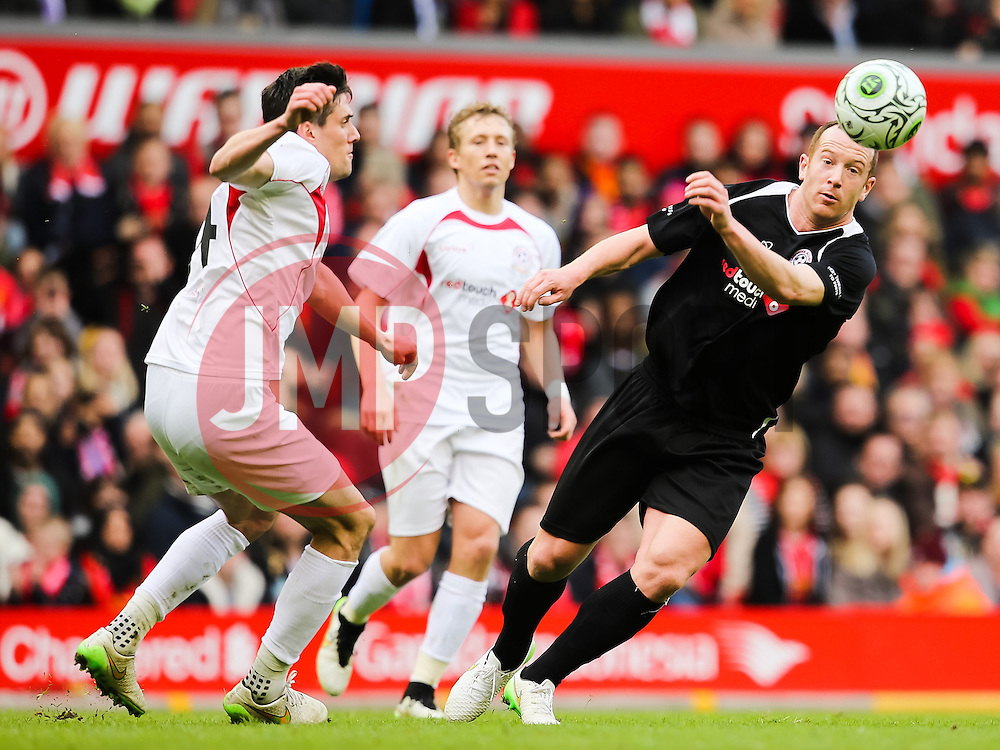 Charlie Adam flicks the ball past Martin Kelly - Photo mandatory by-line: Dougie Allward/JMP - Mobile: 07966 386802 - 29/03/2015 - SPORT - Football - Liverpool - Anfield Stadium - Gerrard's Squad v Carragher's Squad - Liverpool FC All stars Game
