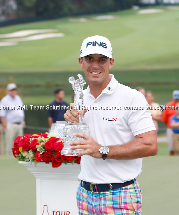 September 14, 2014:  Billy Horschel holds the Tour Championship trophy after winning the FedEx Cup - The Tour Championship at East Lake Golf Club in Atlanta, Georgia.