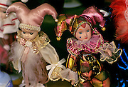Image of Mardi Gras jester dolls in a shop window on Royal Street in the French Quarter, New Orleans, Louisiana, American South