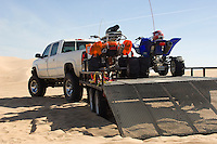 ATVs on Trailer Behind Pickup Truck