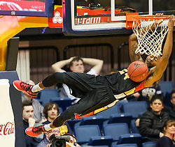 Dec 16, 2017; Morgantown, WV, USA; Wheeling Jesuit Cardinals guard Haywood Highsmith (24) dunks the ball during the first half against the West Virginia Mountaineers at WVU Coliseum. Mandatory Credit: Ben Queen-USA TODAY Sports