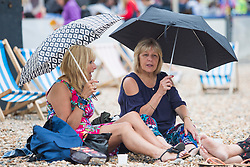 © Licensed to London News Pictures. 28/05/2017. Brighton, UK. Members of the public brave the grey clouds to spent some time on the beach in Brighton and Hove on the Bank holiday weekend as the occasional rain shower hits the seaside resort. Photo credit: Hugo Michiels/LNP