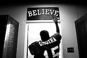 "Heeding a pre-game ritual, senior Gurwinder Ghotra touches the ""Believe"" sign posted above the Atwater High Falcons' locker room door before Friday night football in Atwater, California."