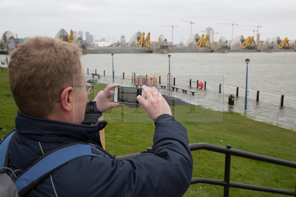 © Licensed to London News Pictures. 21/03/2015. The Thames Barrier has closed for the 175th time today in its over 30 year lifespan. The closure was prompted by a very high tide and the barrier was raised to protect London. This is the first operational closure of 2015 and the first of the 2014/2015 winter season. Other closures have occured only for test purposes in this period. As the moment of high tide approached, the river flooded on to the path in Barrier Gardens. Short embeddable video clip at https://vine.co/v/OYntVAYh0xJ Credit : Rob Powell/LNP