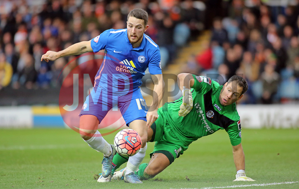 Conor Washington of Peterborough United holds off Mark Tyler of Luton Town - Mandatory byline: Joe Dent/JMP - 06/12/2015 - Football - ABAX Stadium - Peterborough, England - Peterborough United v Luton Town - FA Cup