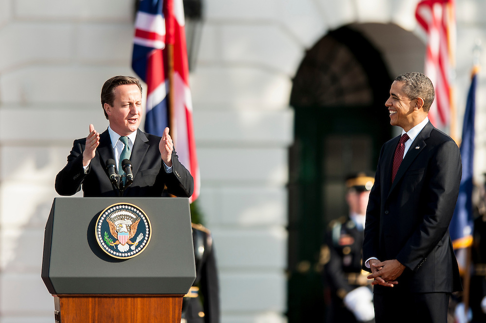 President BARACK OBAMA welcomes British Prime Minister DAVID CAMERON and his wife Samantha to the White House during an official arrival ceremony on the South Lawn.