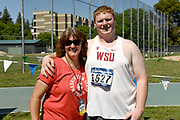 May24, 2018; Sacramento, CA, USA; Brock Eager of Washington State (right) poses with throws coach Julie Taylor after placing third in the hammer at 225-2 (68.64m)  during the NCAA West Preliminary at Hornet Stadium.