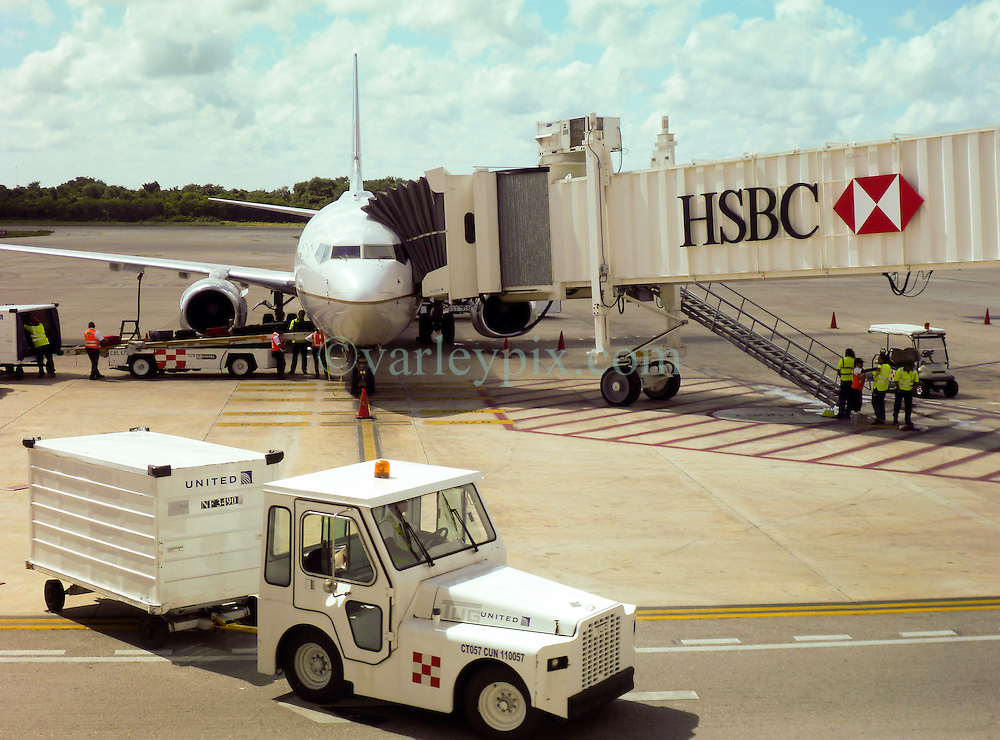 06 Feb 2014. Cancun International Airport, Mexico.<br /> A plane sits at the gate.<br /> Photo; Charlie Varley/varleypix.com