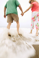Couple Getting Feet Wet at Beach