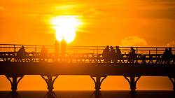 © Licenced to London News Pictures<br /> Aberystwyth Wales UK, Monday 17 September 2018<br /> <br /> UK Weather:  People on the pier in Aberystwyth enjoying a drink in  the remarkably warm weather as they wait for Storm Helene to roll in overnight. <br /> The west of the UK is bracing itself for the impact of Storm Helene, which is predicted to strike tonight and into tomorrow morning, with winds gusting up to 70mph in exposed areas and the risk of danger to life from flying debris<br /> <br /> <br /> Photo © Keith Morris / / LNP