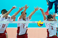 Poland's Mariusz Wlazly (left) and Karol Klos and Michal Winiarski defend while volleyball final match between Brazil and Poland during the 2014 FIVB Volleyball World Championships at Spodek Hall in Katowice on September 21, 2014.<br /> <br /> Poland, Katowice, September 21, 2014<br /> <br /> For editorial use only. Any commercial or promotional use requires permission.<br /> <br /> Mandatory credit:<br /> Photo by © Adam Nurkiewicz / Mediasport