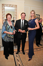 Left to right, SIR TERRY & LADY WOGAN and JODIE KIDD at a reception and dinner in association with Martell to launch Raymond Blanc's personal crusade to 'Celebrate French Craftsmanship in the UK' held at the Mandarin Oriental Hotel followed by dinner in the windows of Harrods, Knightsbridge, London on 18th October 2011.
