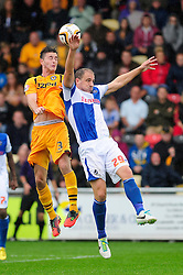 Bristol Rovers' Mark McChrystal and Newport County's Andrew Hughes compete for a header - Photo mandatory by-line: Dougie Allward/JMP - Tel: Mobile: 07966 386802 17/08/2013 - SPORT - FOOTBALL - Rodney Parade - London - Newport County V Bristol Rovers - Sky Bet league two