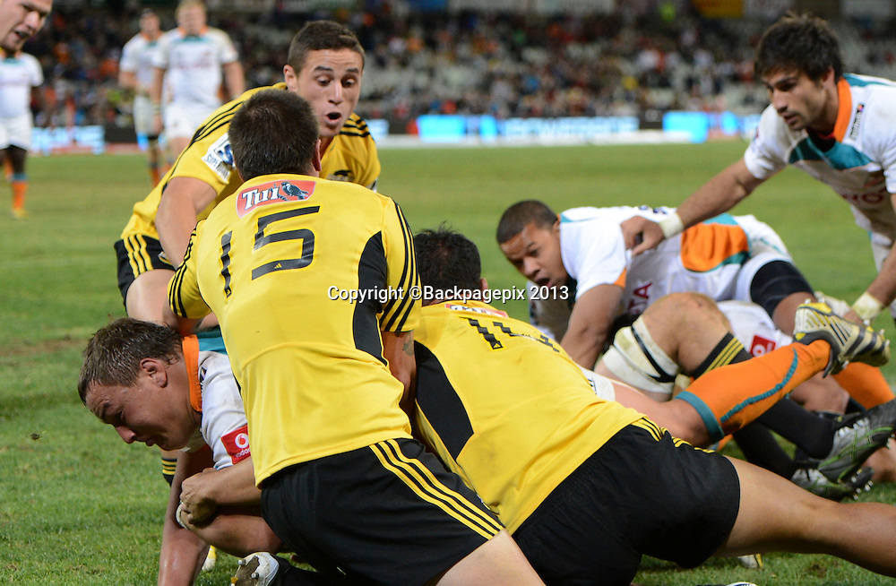 Coenie Oosthuisen of the Cheetahs scores a try during the Super Rugby match between the Cheetahs and the Hurricanes at the Free State Stadium in Bloemfontein on May 10, 2013©Barry Aldworth/BackpagePix