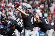 Oakland Raiders quarterback Derek Carr (4) passes the ball against the Atlanta Falcons at Oakland Coliseum in Oakland, Calif., on September 18, 2016. (Stan Olszewski/Special to S.F. Examiner)