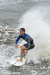 September 10, 2017 - Folly Beach, SC, United States - A surfer enjoys the extreme waves caused by a tidal serge from Hurricane Irma at the Folly Washout September 10, 2017 in Folly Beach, South Carolina. Imra is expected to spare the Charleston area but hurricane will bring a tidal serge and will cause flooding along the coast. (Credit Image: © Richard Ellis via ZUMA Wire)