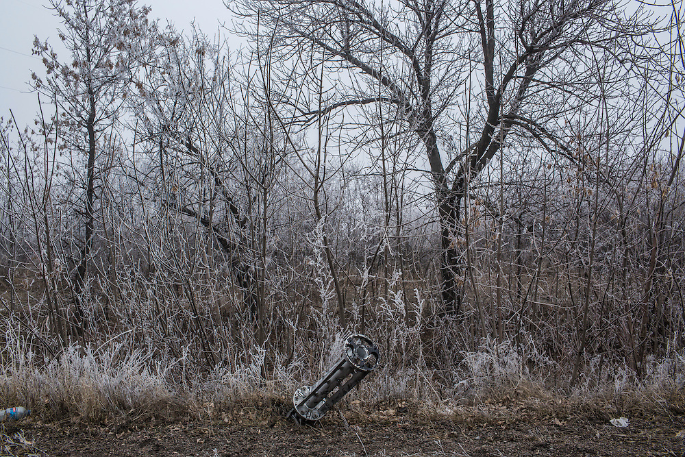 LUGANSKOYE, UKRAINE - FEBRUARY 15: The remnants of a rocket along the road to the embattled town of Debaltseve on February 15, 2015 in Luganskoye, Ukraine. A ceasefire scheduled to go into effect at midnight was reportedly observed along most of the front, save for near the embattled town of Debaltseve. (Photo by Brendan Hoffman/Getty Images) *** Local Caption ***