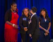 Houston ISD Trustees Wanda Adams, Rhonda Skillern-Jones and Diana Davila congratulate students during Scholars Banquet at the Westin Galleria, April 11, 2017.