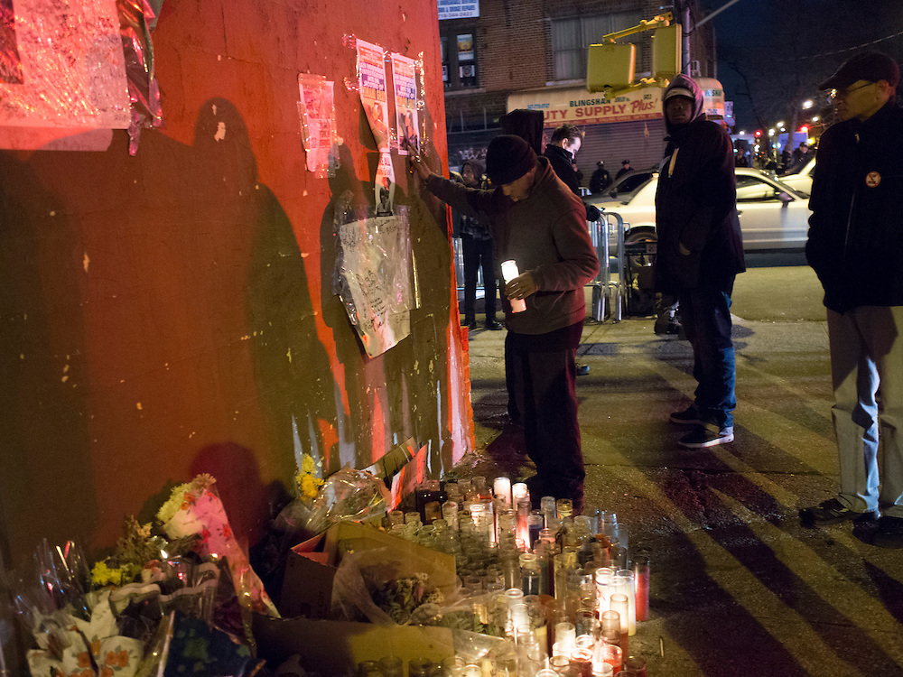 Kamal Holder, center, with a candle at a memorial for Kimani Gray at E 55 St and Church Ave in Brooklyn, NY on Sunday, March 17, 2013...Photograph by Andrew Hinderaker