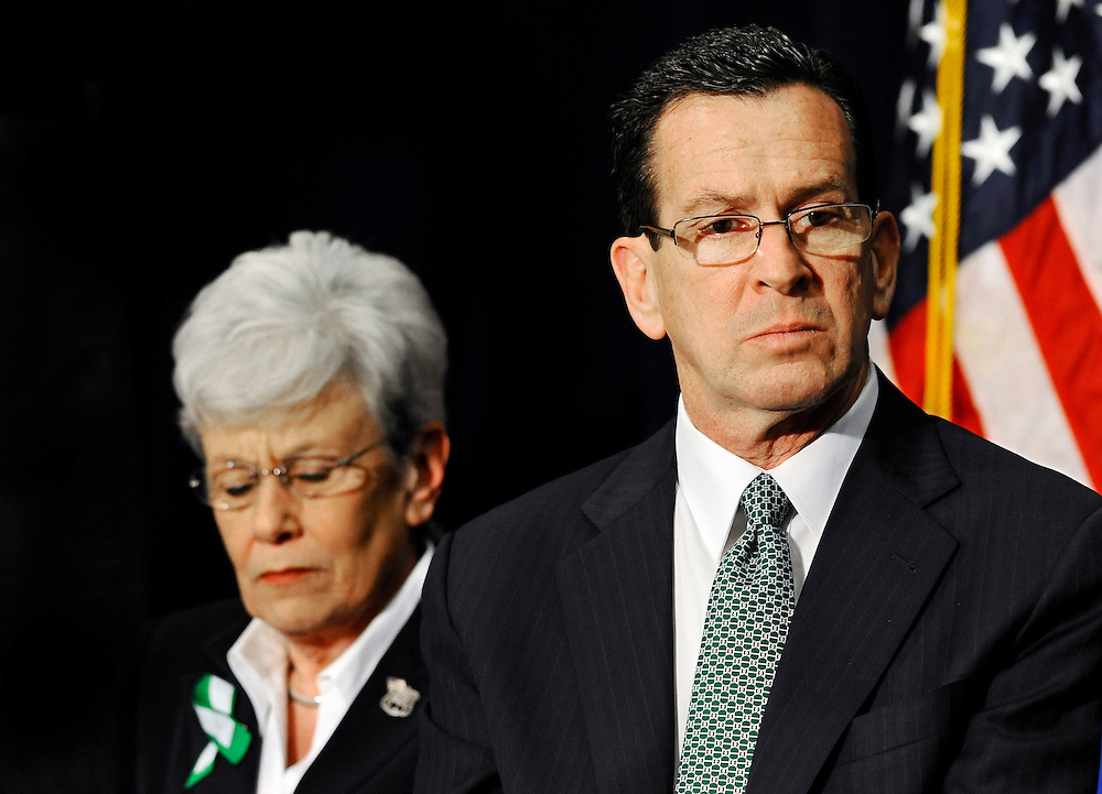 Connecticut Gov. Dannel P. Malloy, right, and Lt. Gov. Nancy Wyman, left, listen to Vice President Joe Biden speak at a gun violence conference in Danbury, Conn., Thursday, Feb. 21, 2013. The conference, organized by members of the state's congressional delegation is to push President Barack Obama's gun control proposals. (AP Photo/Jessica Hill)