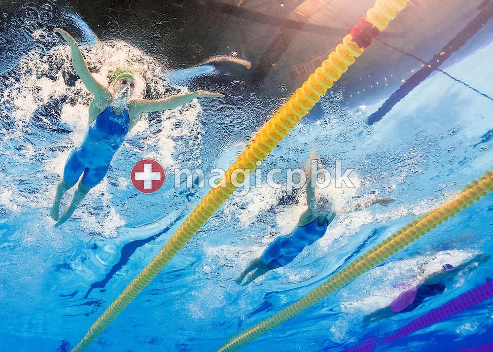 (L-R) Ruta Meilutyte of Lithuania, Yuliya Efimova of Russia and Marina Garcia Urzainqui of Spain compete in the women's 100m Breaststroke Semifinal during the 15th FINA World Aquatics Championships at the Palau Sant Jordi in Barcelona, Spain, Monday, July 29, 2013. (Photo by Patrick B. Kraemer / MAGICPBK)