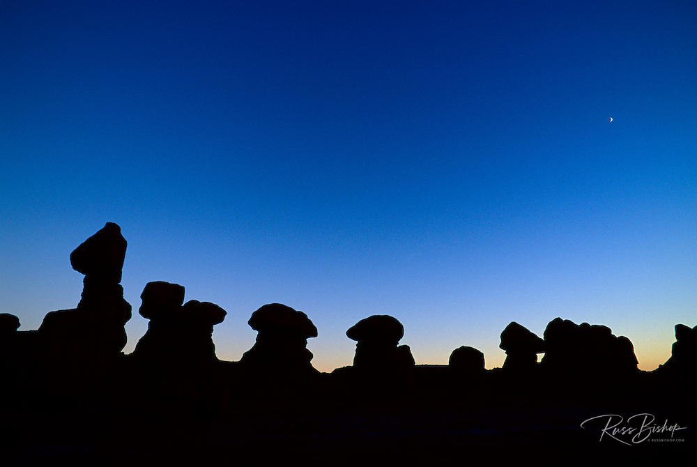 Silhouetted rock formations at dusk in Goblin Valley, Goblin Valley State Park, Utah