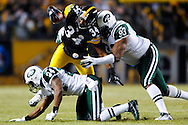 PITTSBURGH, PA - JANUARY 23: Rashard Mendenhall #34 of the Pittsburgh Steelers rushes and is tackled by Trevor Pryce #93 of the New York Jets in the AFC Championship Playoff Game at Heinz Field on January 23, 2011 in Pittsburgh, Pennsylvania(Photo by: Rob Tringali) *** Local Caption *** Rashard Mendenhall;Trevor Pryce