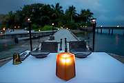 A candle lite dinner table on Song Saa island.