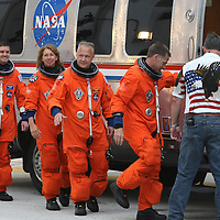 The space shuttle Atlantis astronauts left to right, mission specialists Rex Walheim, Sandy Magnus, pilot Doug Hurley and commander Chris Ferguson enter their vehicle after leaving the operations and check-out building on their way to the pad at the Kennedy Space Center Friday, July 8, 2011, in Cape Canaveral, Fla. Shuttle Atlantis is scheduled to launch on Friday, July 8 and is the 135th and final space shuttle launch for NASA..  (AP Photo/Alex Menendez)