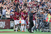 West Ham United forward Marko Arnautovic (7) celebrates his goal in bubbles, Manchester United Manager Jose Mourinho looks on during the Premier League match between West Ham United and Manchester United at the London Stadium, London, England on 29 September 2018.