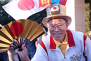The gold hat man is becoming legendary in Japan as he seems to attend every day of every sumo tournament. He enthusiastically follows the sport and is often seen the the crowd during every tournament, wearing his gold hat and waving his gold fan.