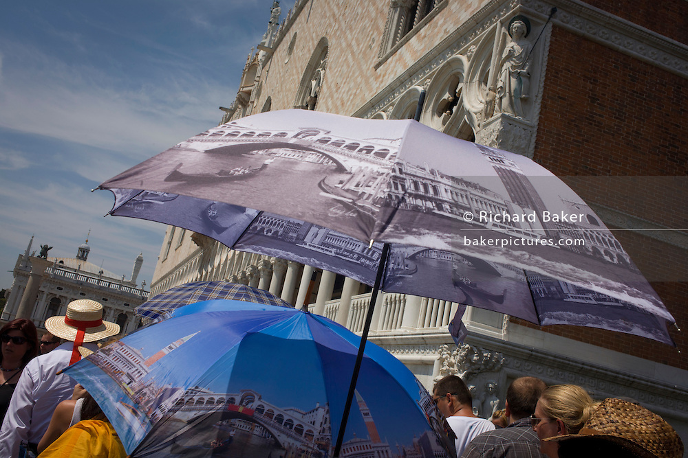 Tourist umbrellas in Piazza San Marco, Venice, Italy