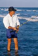 Man surf fishing, Outer Banks, North Carolina