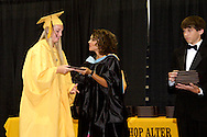 Alter principal Lourdes Lambert (center) during the 47th commencement excercise of Archbishop Alter High School at Trent Arena in Kettering, Saturday, May 26, 2012.