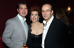 Left to right, JIMMY CARR, CLEO ROCCOS and PAUL MCKENNA at a party to celebrate the publication of Paul McKenna's new book 'I Can Make You Thin' held at the Soho Hotel, 4 Richmond Mews, London W1 on 8th March 2005.<br />