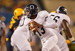 Sep 5, 2015; Morgantown, WV, USA; Georgia Southern Eagles quarterback Favian Upshaw rolls out of the pocket during the first half against the West Virginia Mountaineers at Milan Puskar Stadium. Mandatory Credit: Ben Queen-USA TODAY Sports