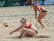 STARE JABLONKI POLAND - July 2:  Barbara Hansel /1/ and Katharina Schutzenhofer /2/ of Austria in action during Day 2 of the FIVB Beach Volleyball World Championships on July 2, 2013 in Stare Jablonki Poland.  (Photo by Piotr Hawalej)