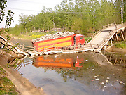 HUAIAN, CHINA - (CHINA OUT) <br /> <br /> A Bridge Collapsed Under A Truck <br /> <br /> A truck carrying stones is seen after collapsing a bridge  in Huaian, Jiangsu Province of China. The bridge, which was built 20 hours ago, collapsed due to a truck filled with stones crossing it on Thursday.<br /> ©Exclusivepix