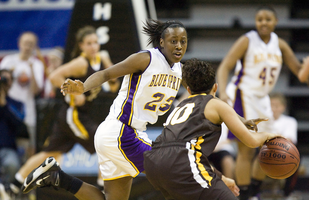 Blue Springs' sophomore guard Tyonna Snow #23 guards Kickapoo's Amanda Landolt #10 during the MSHSAA Class 5 Show-Me Showdown semifinal girls basketball game between the Blue Springs Wildcats and the Kickapoo Lady Chiefs, Thursday evening, March 11, 2010 at Mizzou Arena in Columbia, Mo. Blue Springs beat Kickapoo 52-41. Photo by Patrick T. Fallon/ For the Kansas City Star