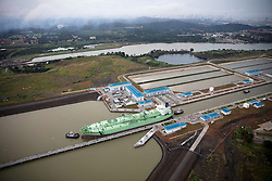 Green oil tanker navigating the Miraflores Locks at the Panama Canal.