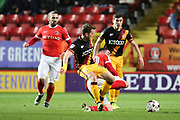 Charlton Athletic striker Lee Novak (30) tackling Bradford City striker Billy Clarke (10)  during the EFL Sky Bet League 1 match between Charlton Athletic and Bradford City at The Valley, London, England on 14 March 2017. Photo by Matthew Redman.
