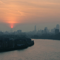 View of The Shard and the sunset over the docklands in East London.