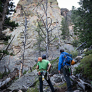 Jonathan Thompson (blue jacket) and our climbing guide Brett _____TBC____? assess the climb for a night of cliff camping