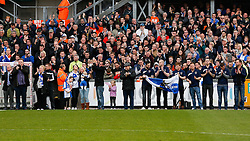 The Family of Ben Hiscox, the local footballer who died after a freak accident in a game last Saturday, stand by the side of the pitch as a one minute's applause is held in his memory - Photo mandatory by-line: Rogan Thomson/JMP - 07966 386802 - 03/04/2015 - SPORT - FOOTBALL - Bristol, England - Memorial Stadium - Bristol Rovers v Chester - Vanarama Conference Premier.