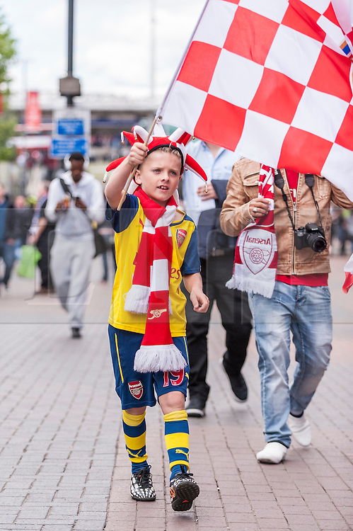 © Licensed to London News Pictures. 30/05/2015. London, UK. A young Arsenal supporter waves a flag, as fans gather at Wembley Stadium for the FA Cup Final 2015, between Arsenal and Aston Villa. Photo credit : Stephen Chung/LNP